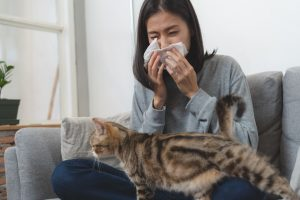 Women with flu symptoms and her pet